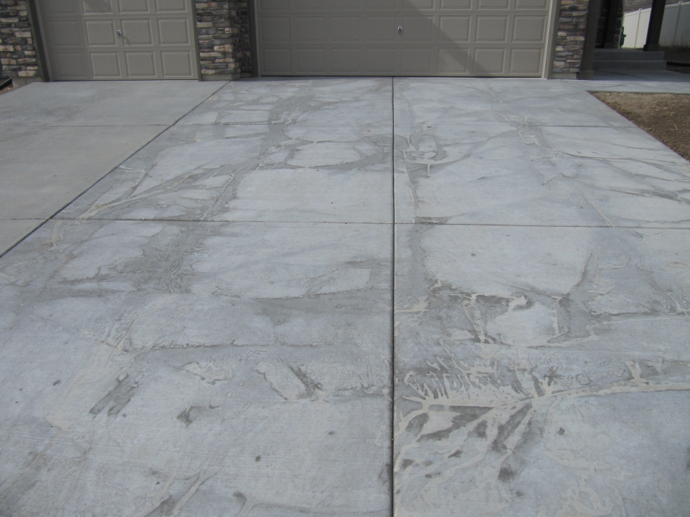 New concrete driveway stained concrete stone masonry for Getting stains off concrete
